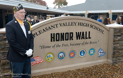 Chico Veterans Honor Guard Member Hank Snow stands beside a wall of names following the Veterans Glen dedication ceremony at Pleasant Valley High School in Chico, Calif. Wed. Nov. 30, 2016. (Bill Husa -- Enterprise-Record)