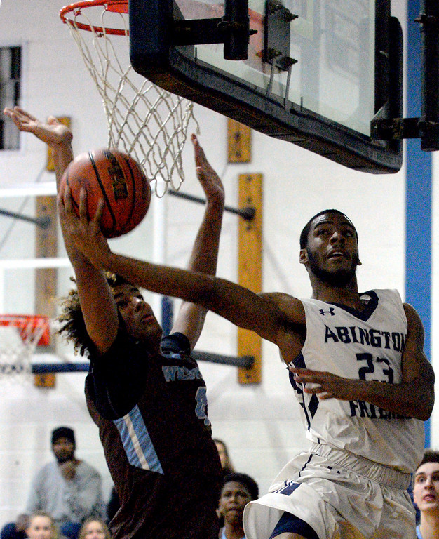 . (Bob Raines--Digital First Media)   Abington Friends\' Ace Bibbs tries to get a lay up past Westtown\'s Jake Forrester Jan. 5, 2018.