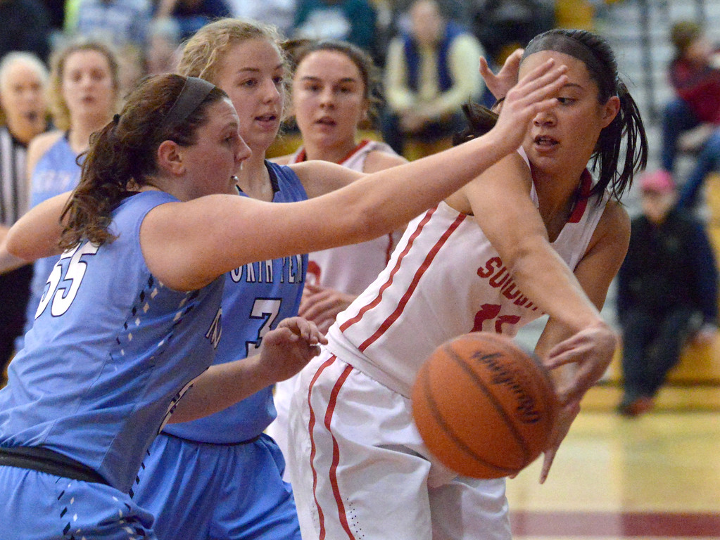 . (Bob Raines--Digital First Media)   Souderton\'s Alana Cardona dishes a pass around North Penn\'s Bri Hewlett Jan. 9, 2018.