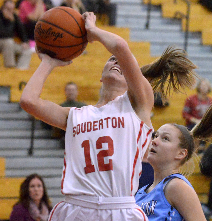 . (Bob Raines--Digital First Media)   Souderton\'s Megan Walbrandt takes a shot past North Penn\'s Alli Lindsay Jan. 9, 2018.