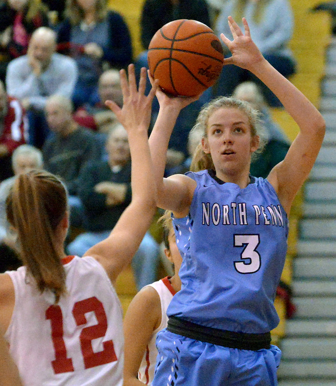 . (Bob Raines--Digital First Media)   North Penn\'s Cayla Sharkey shoots over Souderton\'s Megan Walbrandt Jan. 9, 2018.