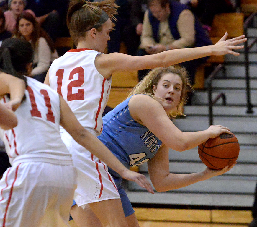 . (Bob Raines--Digital First Media)   North Penn\'s Jess McKenzie looks to make a pass around Souderton\'s Megan Walbrandt Jan. 9, 2018.