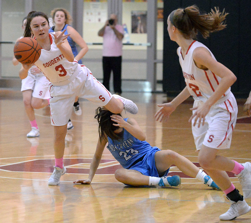 . (Bob Raines--Digital First Media)   Souderton\'s Tori Dowd passes to Megan Walbrandt after fighting for a loose ball with North Penn\'s Carly Adams Jan. 9, 2018.