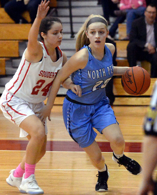 . (Bob Raines--Digital First Media)   North Penn\'s Alaina Mullaly drives for the basket past Souderton\'s Sami Falencki Jan. 9, 2018.