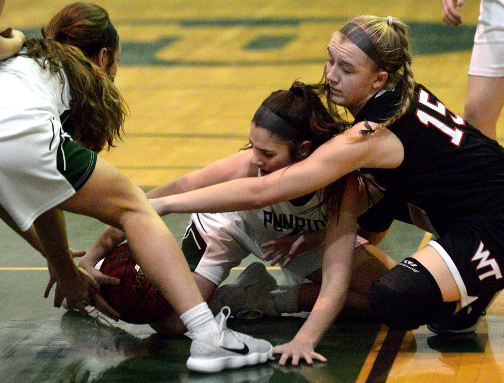 . (Bob Raines/Digital First Media)   Pennridge\'s Brooke Bachtle and Evelyn Loughery fight Tennent\'s Emma Stanfield for the ball Jan. 12, 2017.