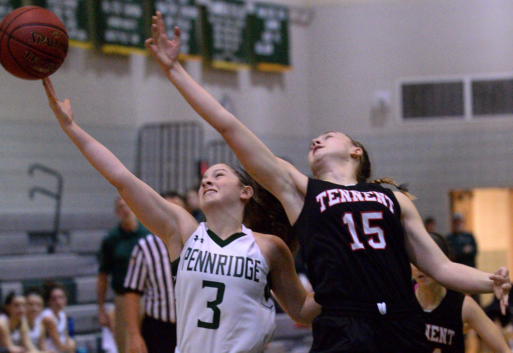 . (Bob Raines/Digital First Media)   Pennridge\'s Sophie Cweiber and Tennent\'s Emma Stanfield stretch for a rebound Jan. 12, 2018