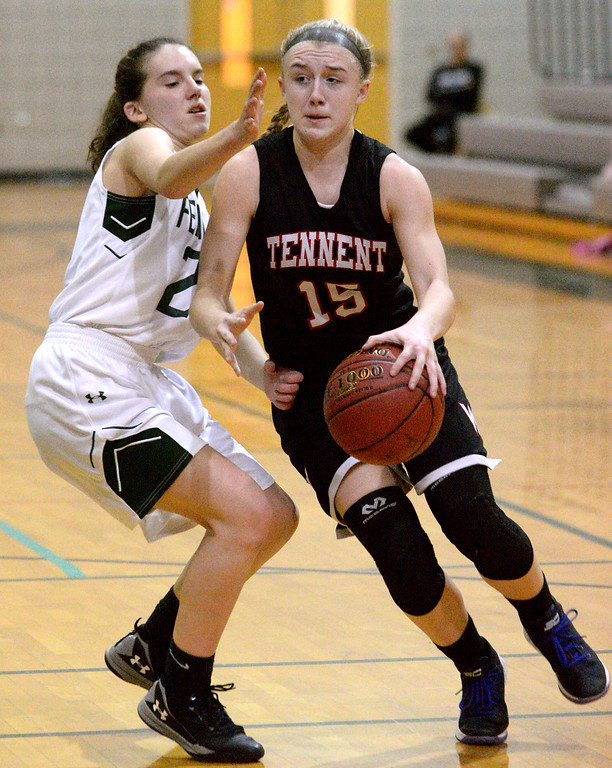 . (Bob Raines/Digital First Media)   Tennent\'s Emma Stanfield drives for the basket past Pennridge\'s Rose Mc Cormick Jan. 12, 2018.