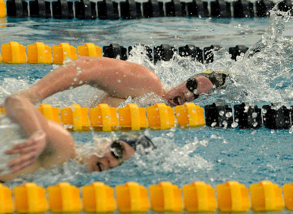 . Mount Saint Joseph Academy\'s Taylor Draganosky moves ahead of Wissahickon\'s Katie Sapozhinkov in the freestyle leg of the 200 yard individual medley Jan. 18, 2018.  (Bob Raines/Digital First Media)