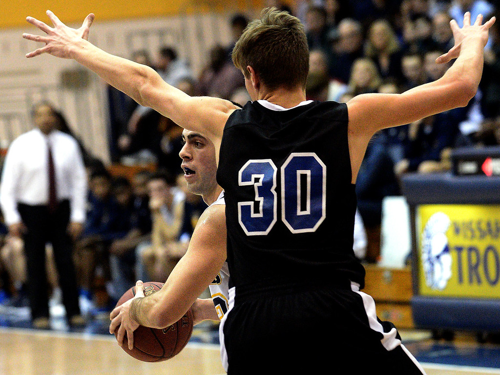. Wissahickon\'s Zach Reiner looks for an outlet when he comes up against Quakertown\'s Kevin Juszynski Jan. 19, 2018.  (Bob Raines/Digital First Media)