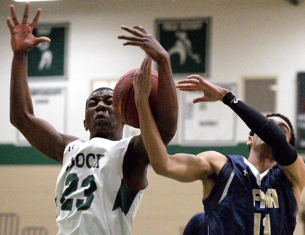 . Christopher Dock\'s Misrahim Nyagwegwe battles Valley Forge Military Academy\'s Arion Lewis for a rebound Jan. 20, 2018.  (Bob Raines/Digital First Media)