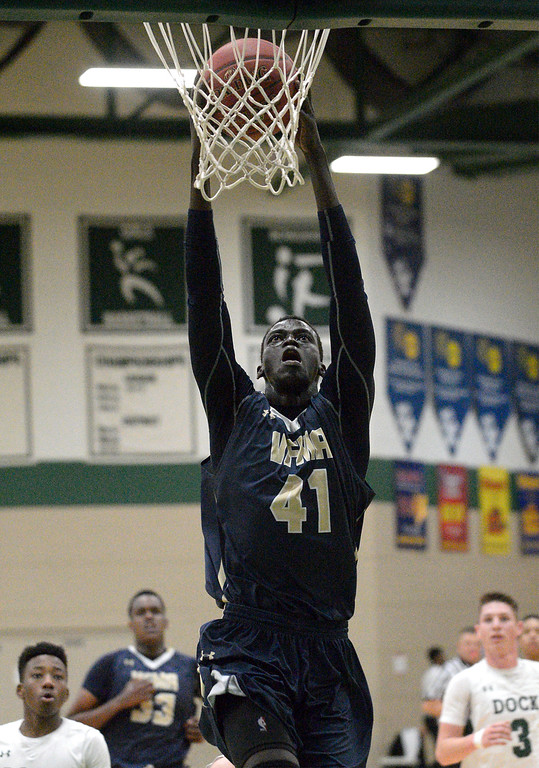 . Valley Forge Military Academy\'s Abraham Deng goes up for a stuff against Christopher Dock Jan. 20, 2018.  (Bob Raines/Digital First Media)