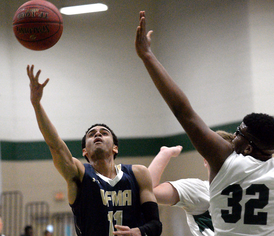 . Valley Forge Military Academy\'s Arion Lewis tries to lay up a shot past Christopher Dock\'s Darius Ellis Jan. 20, 2018.  (Bob Raines/Digital First Media)