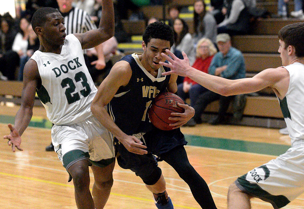 . Valley Forge Military Academy\'s Arion Lewis tries to break through Christopher Dock\'s Misrahim Nyagwegwe and Jackson Scialanca Jan. 20, 2018.  (Bob Raines/Digital First Media)