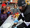 Girls watch Dana Ellis with Boy Scout Troop 51 make hobo pies at the Hatfield Fire and Ice Festival Jan. 21, 2017.  (Bob Raines--Digital First Media)