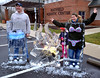 Bob Raines--Digital First Media<br /> Stephan and Andi Lesher pose behind an ice sculpture with swimsuits frozen inside at the Hatfield Fire and Ice Festival Jan. 21, 2017. With them is their daughter, Sofia.