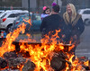 Reegan Reardon watches the fire in the Hatfield Aqautic Center parking lot as her father, Tom, speaks with Niki Kennedy at the Fire and Ice Festival Jan. 21, 2017.  (Bob Raines--Digital First Media)
