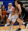 Bri Hewlett (North Penn) charges past Hannah Weiler (Council Rock North) Feb. 11, 2017.  (Bob Raines--Digital First Media)