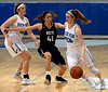 Sam Carangi (North Penn) turns for the basket past Dana Bandurick (Council Rock North) Feb. 11, 2017.  (Bob Raines--Digital First Media)