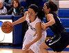 Irisa Yi (North Penn) drives for the basket past Becca Margolis (Council Rock North) Feb. 11, 2017.  (Bob Raines--Digital First Media)