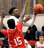 Evan-Eric Longino (Germantown Academy) gets fouled as he shoots by David Robinson (Academy of New Church) Feb. 15, 2017.  (Bob Raines--Digital First Media)