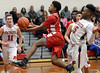 Eli Smith (Academy of New Church) lays up a shot past Eric-Evan Longino (Germantown Academy) Feb. 15, 2017.  (Bob Raines--Digital First Media)