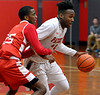 Evan-Eric Longino (Germantown Academy) drives down court past Isaac Marshall (Academy of New Church) Feb. 15, 2017.  (Bob Raines--Digital First Media)