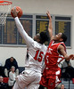 Evan-Eric Longino (Germantown Academy) goes for a shot past Devin Bryant (Academy of New Church) Feb. 15, 2017.  (Bob Raines--Digital First Media)