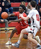 Cameron Thompson (Academy of New Church) passes to the corner away from Andrew Towne (Germantown Academy) Feb. 15, 2017.  (Bob Raines--Digital First Media)