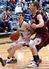 Andrew Funk (Wood)tries to get to the basket past John Wessel (New Oxford) March 10, 2017.  (Bob Raines / Digital First Media)