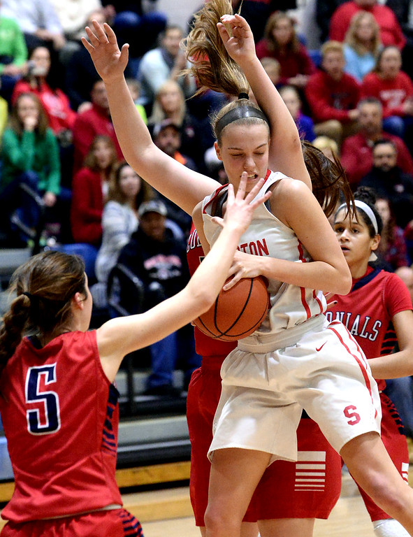 . Megan Walbrandt (Souderton) gets fouled as she comes down with a rebound by Lauren Fortescue and Lauren Coscia (Plymouth Whitemarsh) March 18, 2017.  (Bob Raines / Digital First Media)