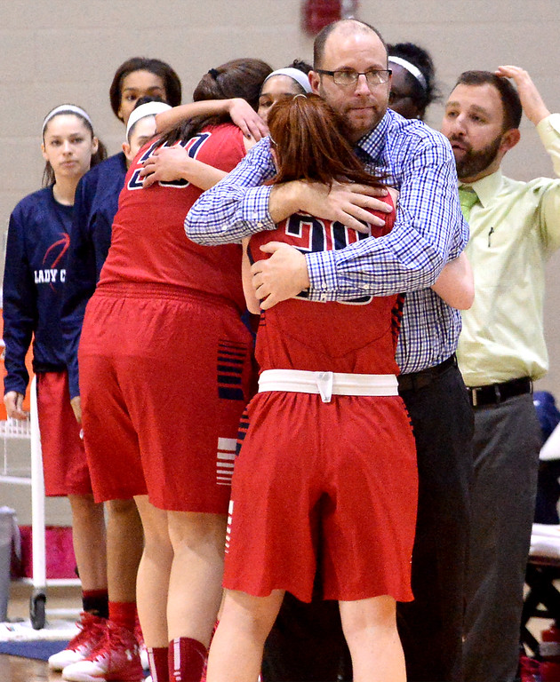 . Coach Dan Dougherty (Plymouth Whitemarsh) hugs his starters as he pulls them out of the game in the final moments of the game against Souderton March 18, 2017.  (Bob Raines / Digital First Media)