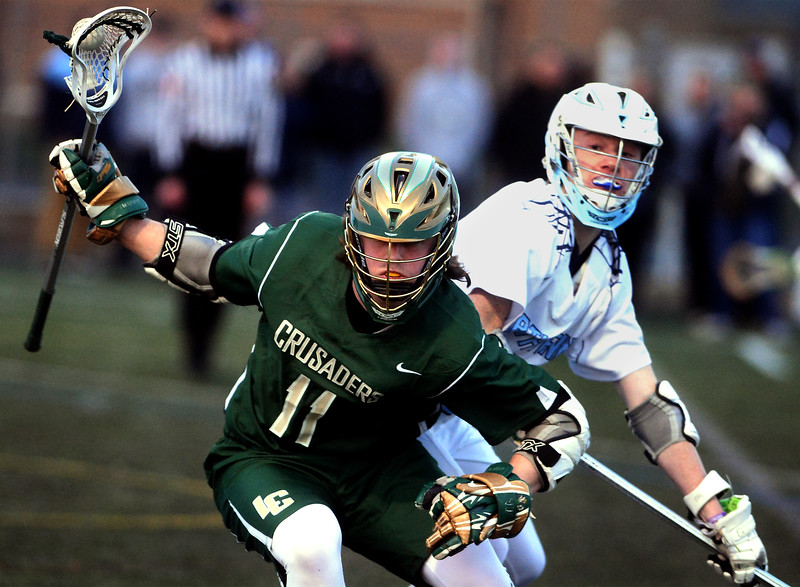 Lansdale Catholic's Mike Basilii dodges a check by North Penn's Jake Nelson March 24, 2017.  (Bob Raines / Digital First Media)