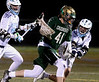 Lansdale Catholic goal keeper Bob  Bausman drives for the North Penn crease harassed by Andrew Alexander and Reece Udinski  March 24, 2017.  (Bob Raines / Digital First Media)