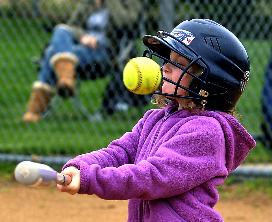 . Molly Schmidt hits a foul pop at the North Penn Little League Softball opening day April 22, 2017.  (Bob Raines/Digital First Media)