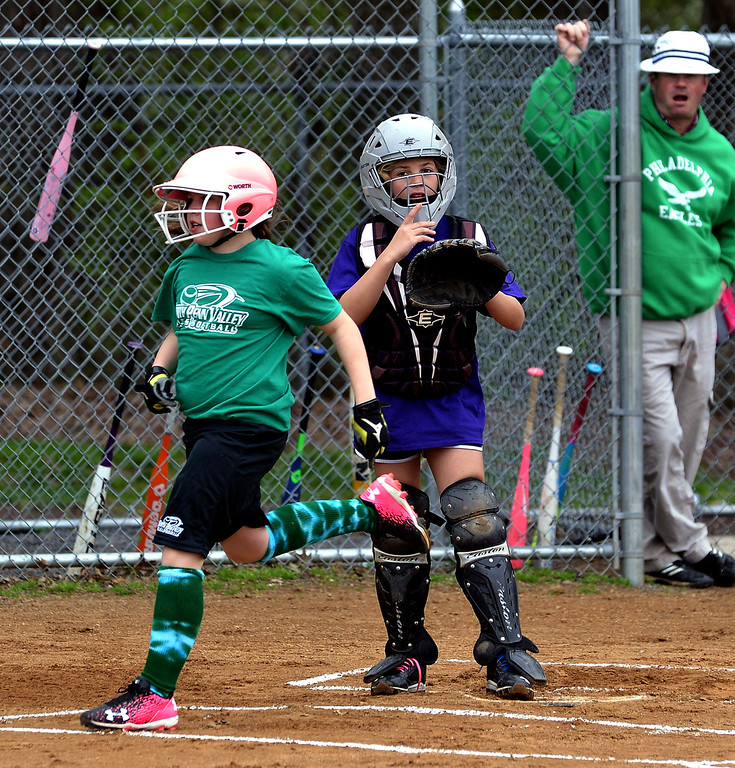 . Kerry McCullagh comes home on an rbi at the North Penn Little League Softball opening day April 22, 2017.  (Bob Raines/Digital First Media)