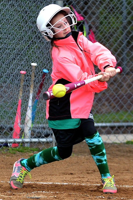. Mackenzie Price gets a piece of the ball at the North Penn Little League Softball opening day April 22, 2017.  (Bob Raines/Digital First Media)