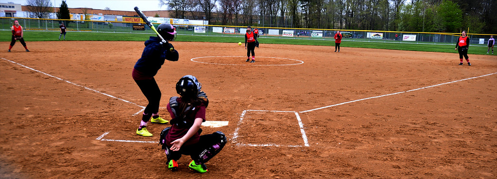 . The 14-under and 13-under softball teams play a scrimmage at the North Penn Little League Softball opening day April 22, 2017.  (Bob Raines/Digital First Media)