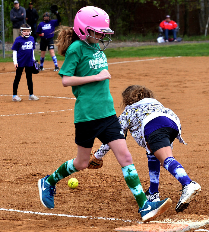 . Amber Hadad makes it to first base on an error at the North Penn Little League Softball opening day April 22, 2017.  (Bob Raines/Digital First Media)