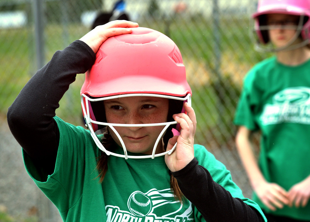 . Julie Budinko gets ready for her turn at bat at the North Penn Little League Softball opening day April 22, 2017.  (Bob Raines/Digital First Media)
