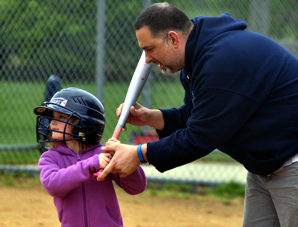 . Coach Lou Iseman helps Molly Schmidt with her batting at the North Penn Little League Softball opening day April 22, 2017.  (Bob Raines/Digital First Media)