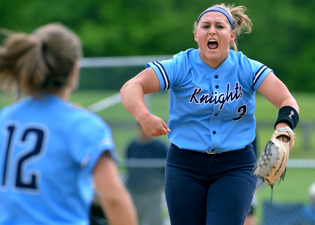 . North Penn\'s Bri Battavio leaps and lets out a yell after throwing the final pitch of the Knights victory over Central Bucks South May 11, 2017.  (Bob Raines/Digital First Media)