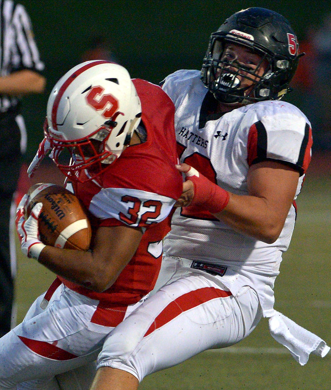 . Hatboro Horsham\'s Nick Chapman drags Souderton runner Dan Pineda to the ground Sept. 8, 2017. / Bob Raines--Digital First Media