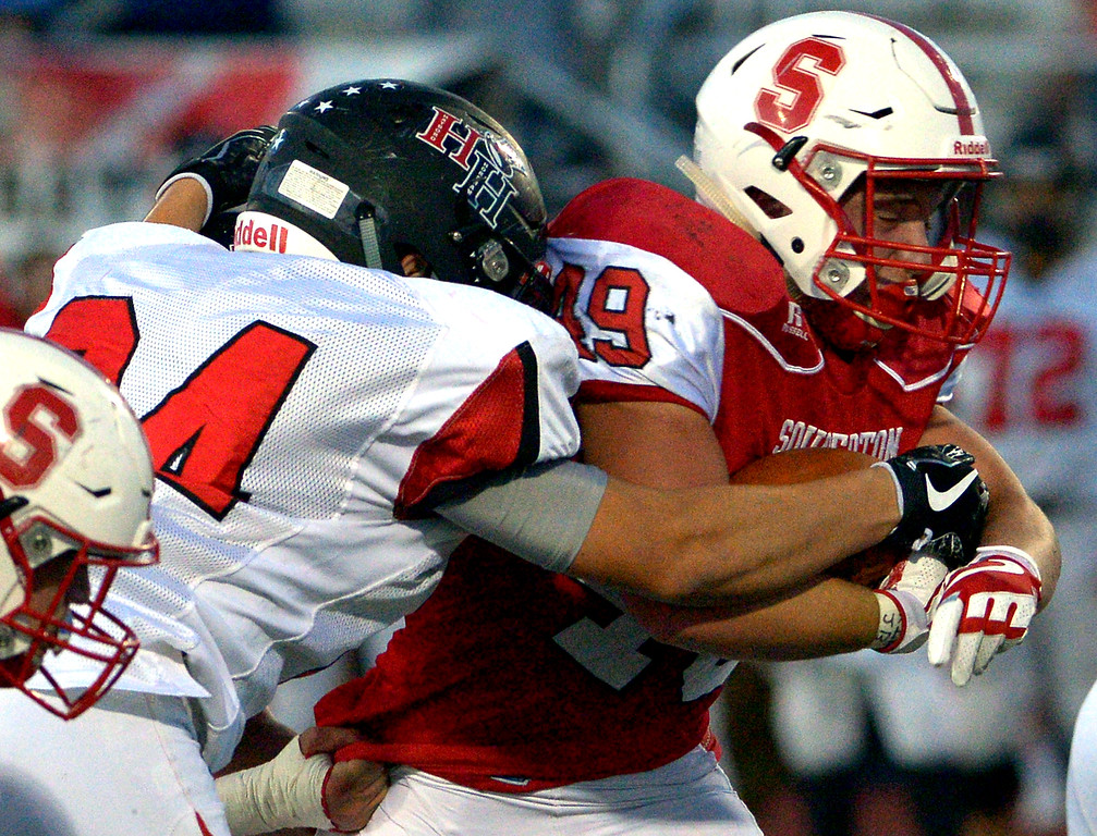 . Hatboro Horsham\'s Jordan Collazo tackles Souderton\'s Jeremy Tammaro Sept. 8, 2017. / Bob Raines--Digital First Media