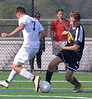 Harry Stackhouse (Cheltenham) turns the ball making Connor Kristoff (Upper Moreland) overshoot Sept. 12, 2017. / Bob Raines--Digital First Media