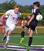 Tyler Holman (Upper Moreland) heads the ball past Max Brown (Cheltenham) Sept. 12, 2017. / Bob Raines--Digital First Media