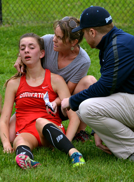 . More than a few runners collapsed at the finish line during the Central Bucks East, Souderton and North Penn cross country tri-meet at North Penn High School Sept. 13, 2017. / Bob Raines--Digital First Media