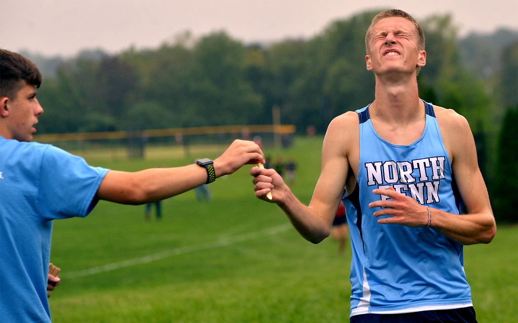 . North Penn\'s Eric Kull grimaces as he finishes first in the cross country tri-meet with Central Bucks East and Souderton at North Penn High School Sept. 13, 2017. / Bob Raines--Digital First Media
