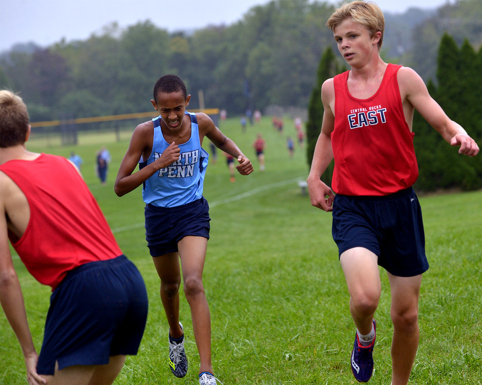 . Central Bucks West\'s Cole Sams wins his battle with North Penn\'s Noah Demis to finish third at the cross country tri-meet at North Penn High School Sept. 13, 2017. / Bob Raines--Digital First Media