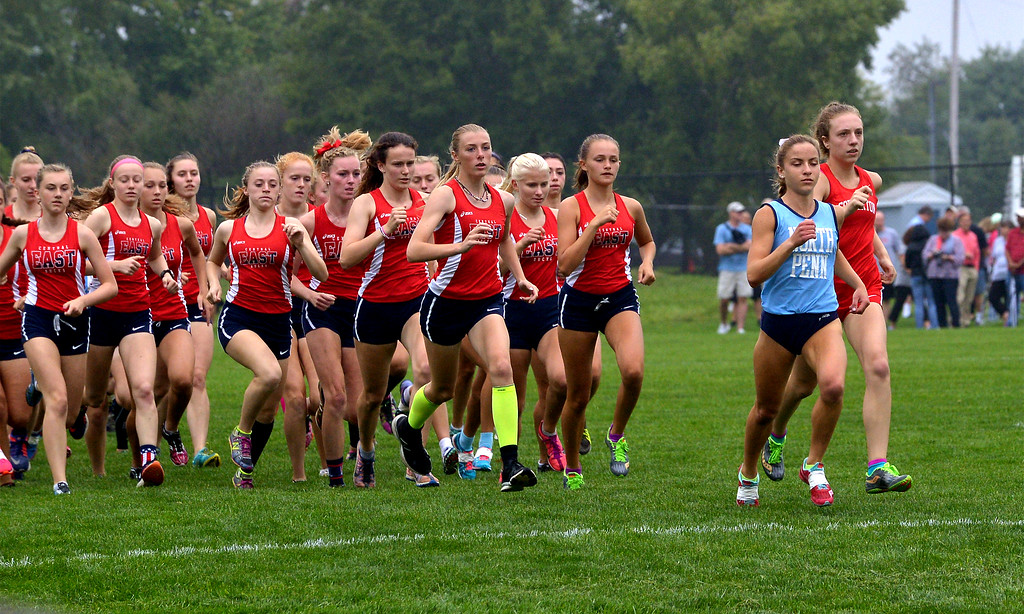 . North Penn\'s Ariana Gardizy and Souderton\'s Emily Bonaventure begin to build a lead at the start that only widened later in the tri-meet with Central Bucks East at North Penn High School Sept. 13, 2017. / Bob Raines--Digital First Media
