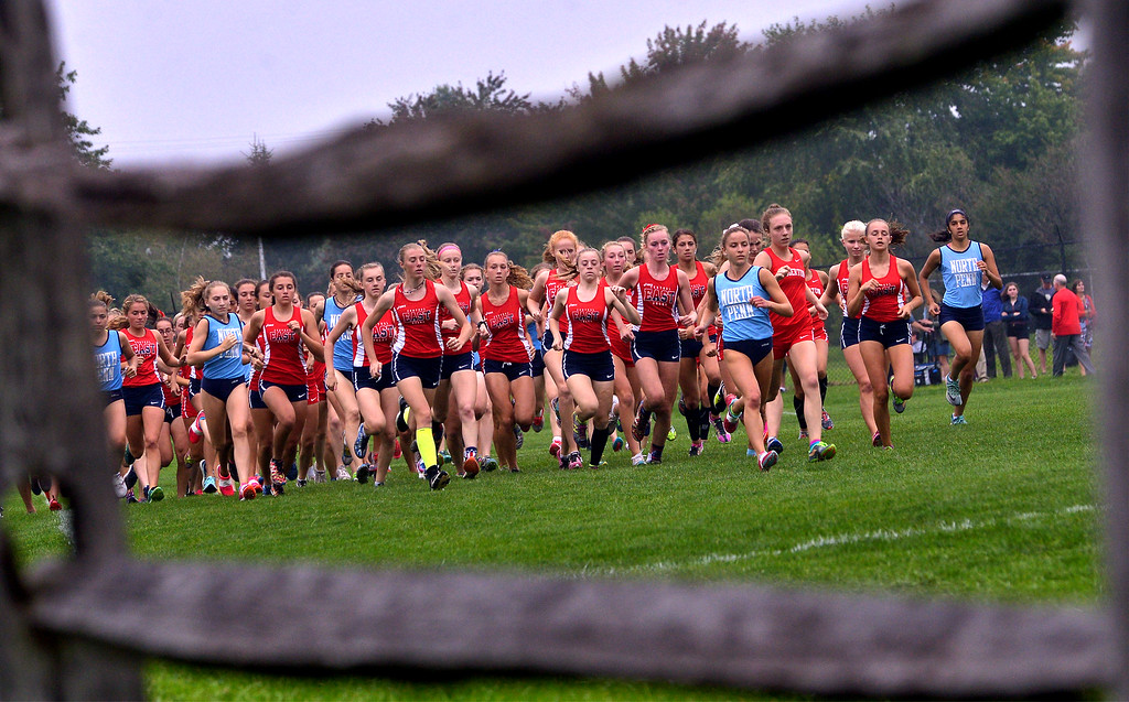 . North Penn Central Bucks East and Souderton girls begin their tour of the North Penn High School campus in across country tri-meet Sept. 13, 2017. / Bob Raines--Digital First Media